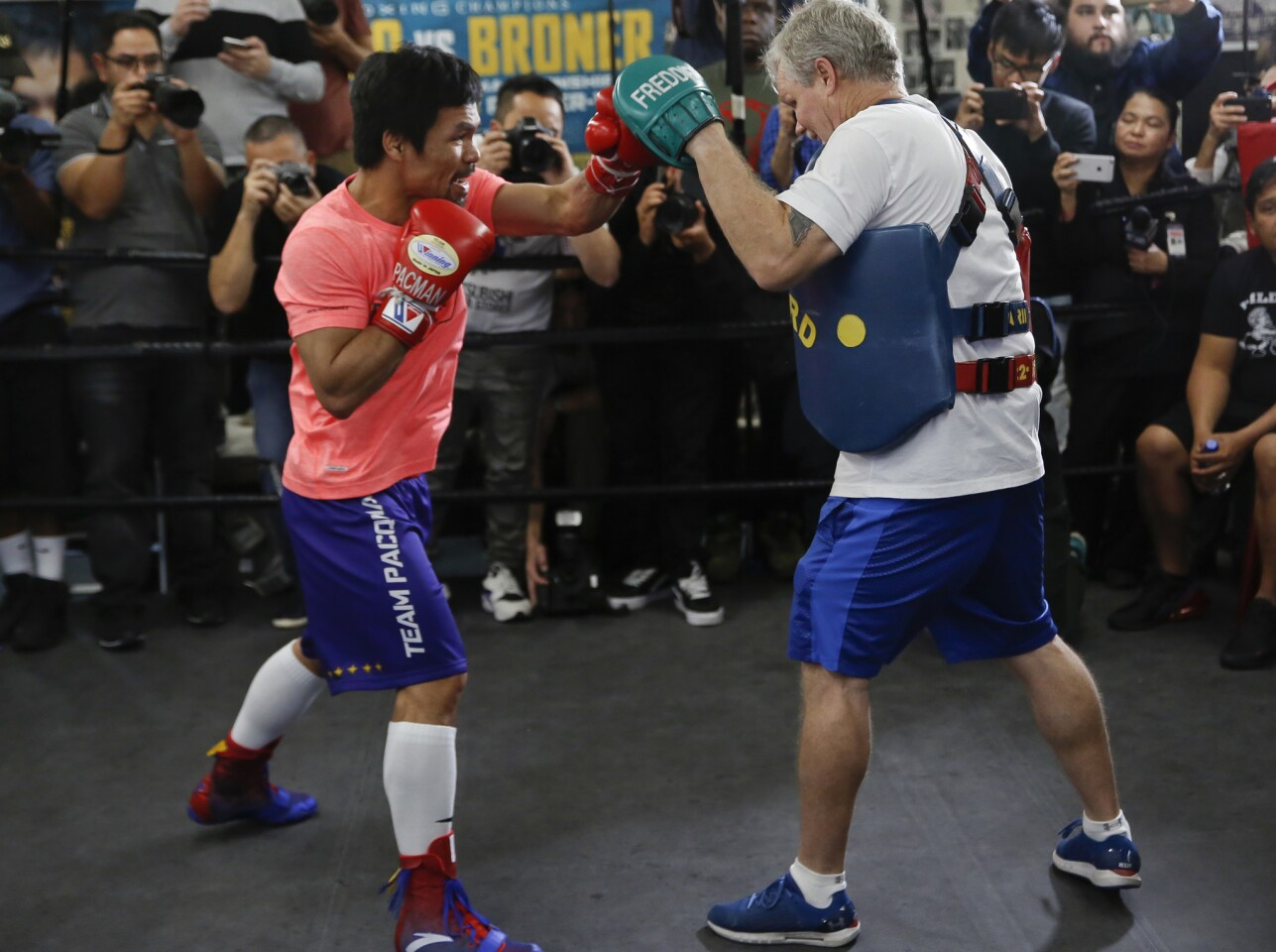 Manny Pacquiao, left, works out with trainer Freddie Roach at a boxing club in Los Angeles, Wednesday, Jan. 9, 2019. Pacquiao is scheduled to defend his WBA welterweight title against Adrien Broner on Jan. 19, 2019, in Las Vegas. (AP Photo/Damian Dovarganes)