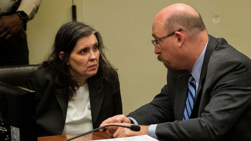 Louise Turpin consults with attorney Jeff Moore before she and her husband David Turpin plead not guilty to multiple felony charges during an arraignment at the Riverside Hall of Justice.