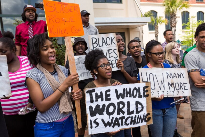 People participate in a rally to protest the killing of Walter Scott.