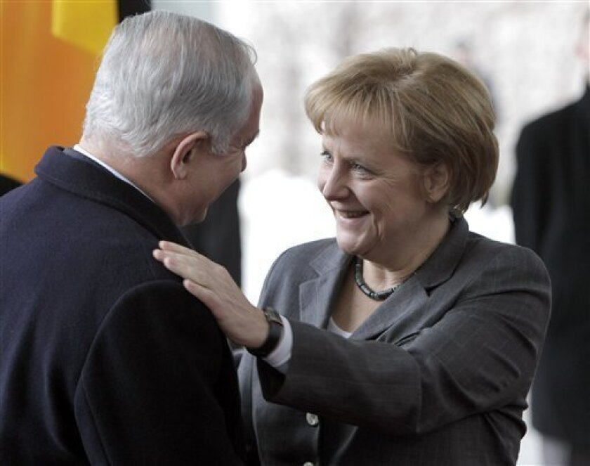 German Chancellor Angela Merkel, right, welcomes Israeli Prime Minister Benjamin Netanyahu, left, for a meeting at the chancellery in Berlin, Germany, Monday, Jan. 18, 2010. High on the agenda Monday will be Germany's push to win the release of a captive Israeli soldier held by Hamas militants and