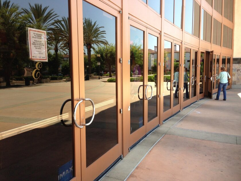 Notices of bag checks are taped to the front doors of the Edwards 18 multiplex in Mira Mesa.