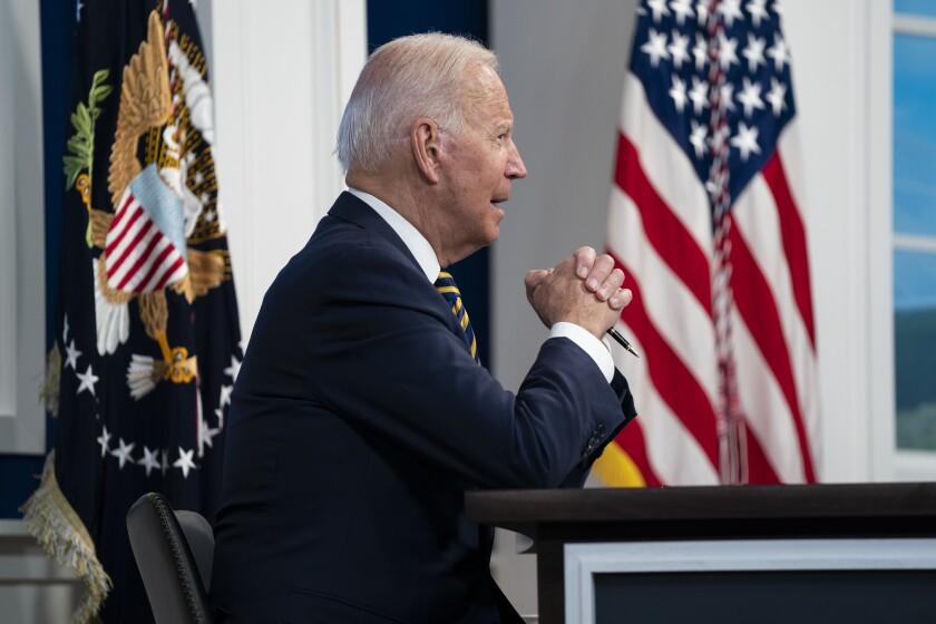 President Joe Biden sitting at a desk.