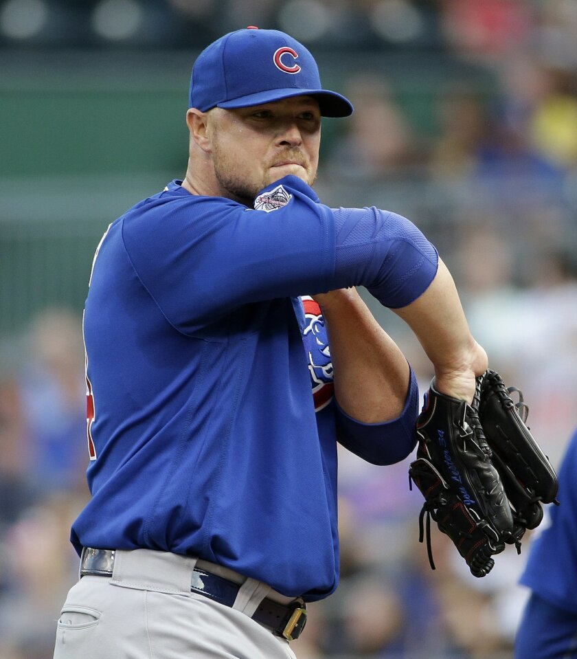 Chicago Cubs starter Jon Lester wipes his face after hitting Pittsburgh Pirates' Josh Harrison with a pitch, forcing in a run, during the second inning of a baseball game in Pittsburgh, Saturday, July 9, 2016. (AP Photo/Gene J. Puskar)
