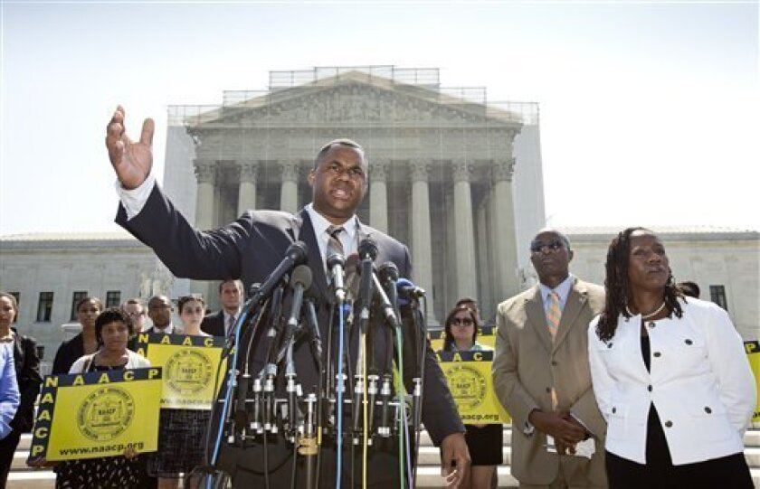 Ryan P. Haygood, director of the NAACP Legal Defense Fund, talks outside the Supreme Court in Washington, Tuesday, June 25, 2013, about the Shelby County v. Holder, a voting rights case in Alabama.