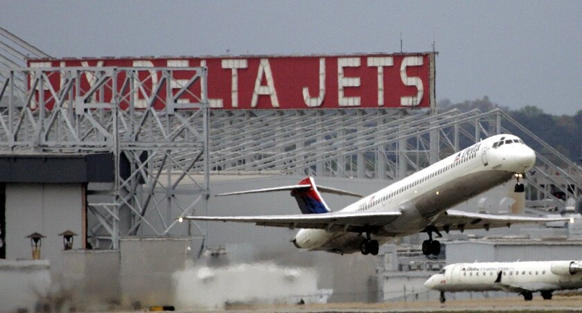 FILE - In this April 14, 2008 file photo, a Delta Airlines jet departs Hartsfield Jackson Atlanta International Airport in Atlanta. Georgia lawmakers could take the rare step of eliminating a corporate tax break this session _ despite opposition from one of the state's largest employers, Delta Airlines. State Rep. Earl Ehrhart's initial proposal would only have cut Delta's exemption from taxes on jet fuel but now would affect all airlines. (AP Photo/John Bazemore, file)