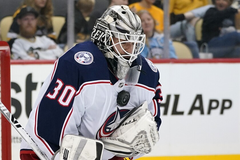 Columbus Blue Jackets goalie Jean-Francois Berube blocks a shot during the second period of an NHL exhibition hockey game against the Pittsburgh Penguins in Pittsburgh, Monday, Sept. 27, 2021. (AP Photo/Gene J. Puskar)