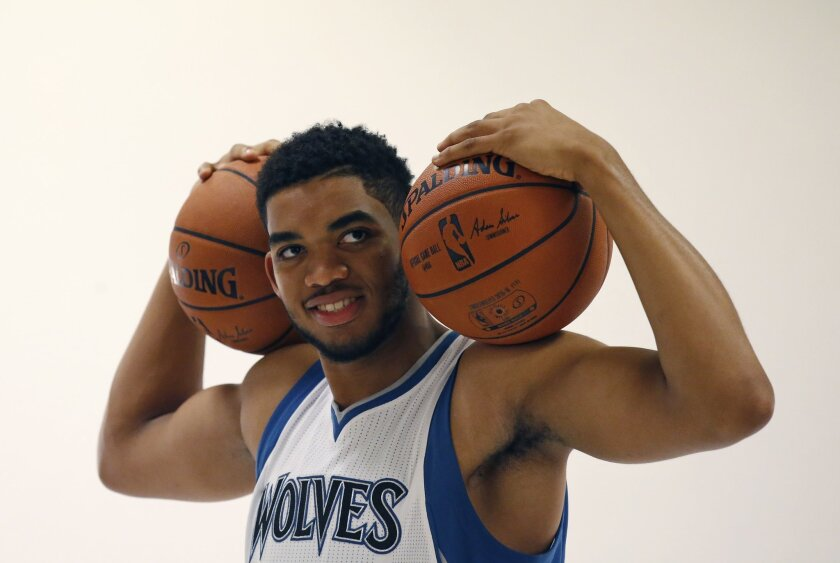 Minnesota Timberwolves center Karl-Anthony Towns poses for photos during NBA basketball media day in Minneapolis, Monday, Sept. 28, 2015. (AP Photo/Ann Heisenfelt)