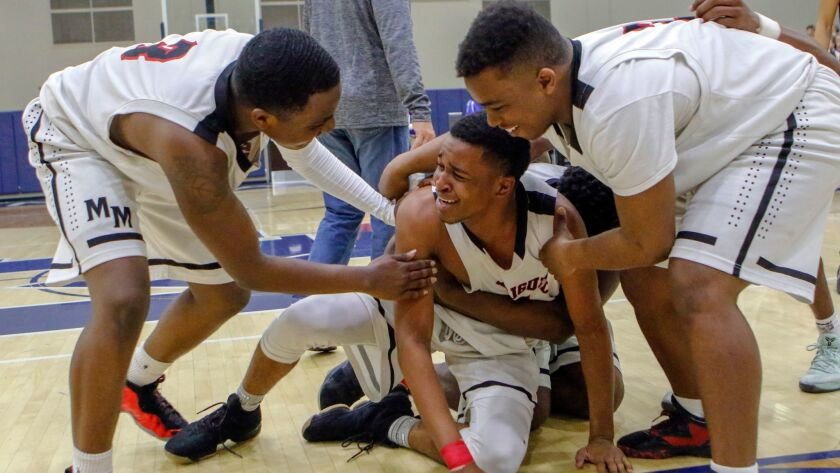 Mount Miguel celebrates after their triple overtime win over Carlsbad in the San Diego Section Divis