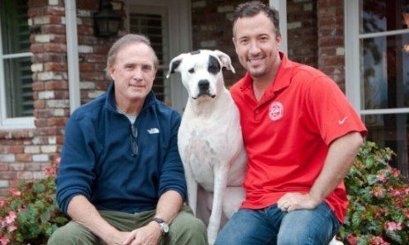 """John Snyder (left) and his dog, Charger, starred in a homemade Doritos commercial, which he submitted into the company's 2012 """"Crash the Super Bowl"""" contest. Rob Kuty (right) trained the dog for the production. Photo: Claire Harlin"""