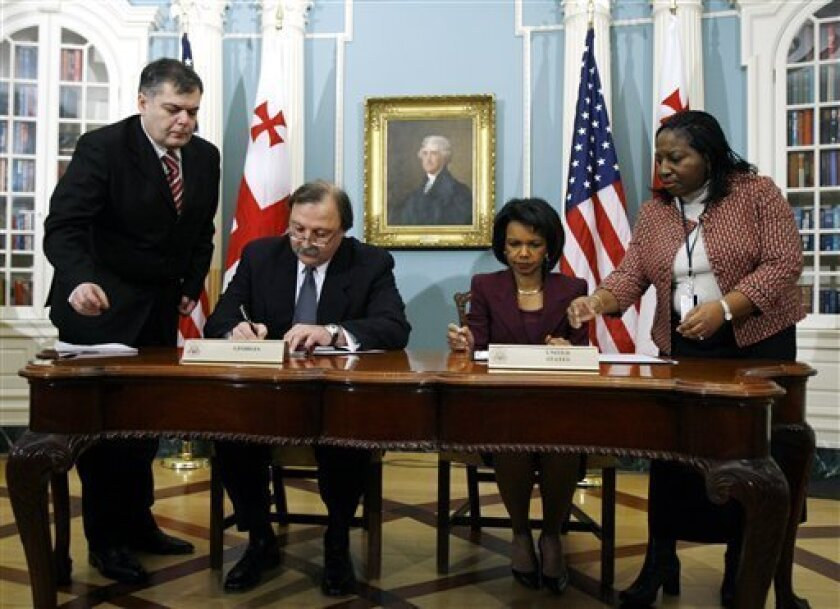 Secretary of State Condoleezza Rice and Georgian Foreign Minister Grigol Vashadze sign bilateral agreements at State Department in Washington, Friday, Jan.. 9, 2009. (AP Photo/Jose Luis Magana)