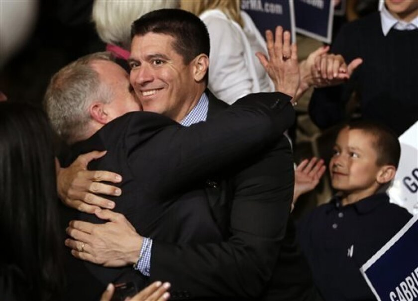 Republican candidate for the U.S. Senate, Gabriel Gomez, center, celebrates with supporters as he makes his way to the stage to address an audience with a victory speech at a watch party, in Cohasset, Mass., Tuesday, April 30, 2013. Gomez won his primary bid for the Republican nomination to contest
