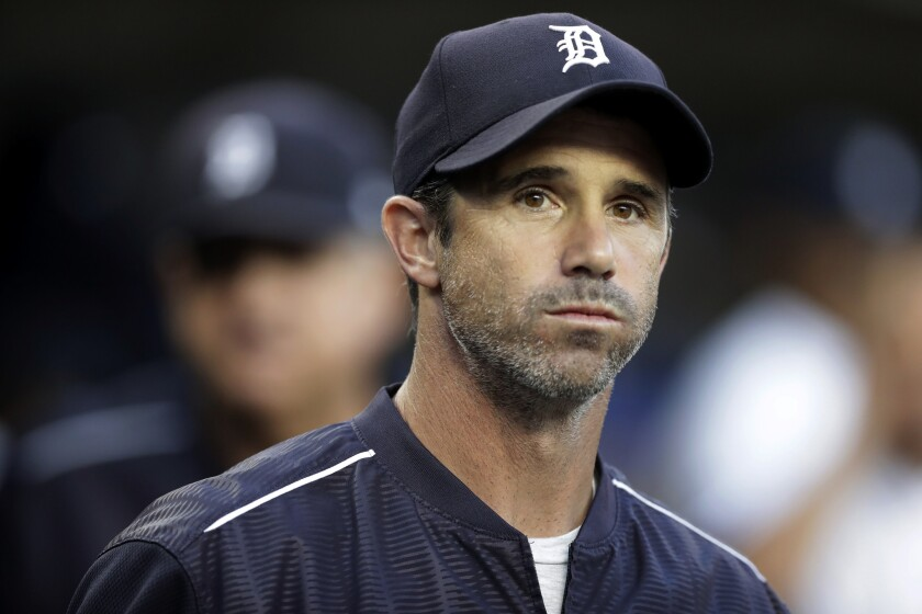 Detroit Tigers manager Brad Ausmus appears in the dugout before a baseball game against the Minnesota Twins, in Detroit. Ausmus has been named the Los Angeles Angels' manager. General manager Billy Eppler on Sunday, Oct. 21, 2018, announced the hiring of Ausmus, who served as his special assistant last season.