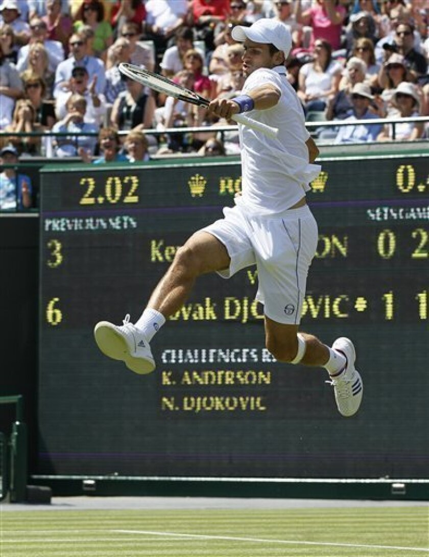 Serbia's Novak Djokovic leaps in the air during the match against South Africa's Kevin Anderson at the All England Lawn Tennis Championships at Wimbledon, Thursday, June 23, 2011. (AP Photo/Kirsty Wigglesworth)