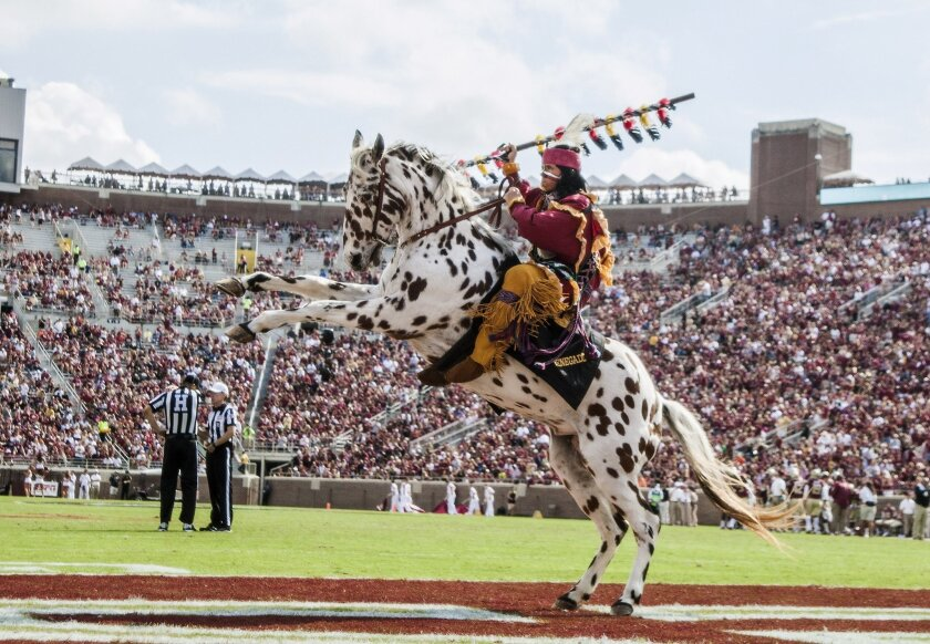 Florida State mascot Osceola riding the horse Renegade celebrates a touchdown in the second half of an NCAA college football game against Syracuse in Tallahassee, Fla., Saturday, Oct. 31.  Florida State defeated Syracuse 45-21. (AP Photo/Mark Wallheiser)