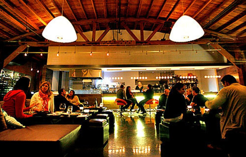 Saluté Wine Bar in Santa Monica is a single big room with L-shaped couches and ottomans along with a few regular tables.