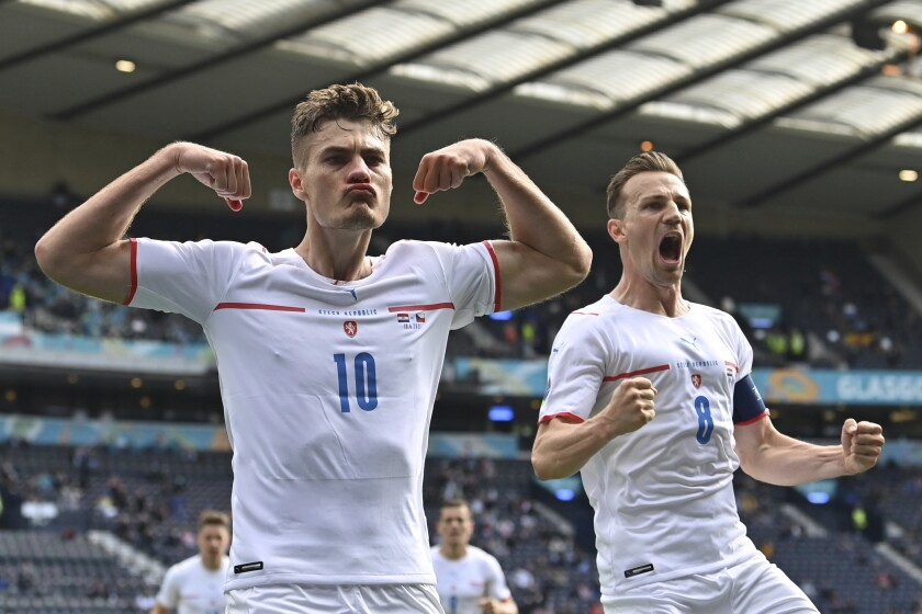 Czech Republic's Patrik Schick, left, celebrates after scoring his side's first goal from the penalty spot during the Euro 2020 soccer championship group D match between Croatia and the Czech Republic at the Hampden Park stadium in Glasgow, Friday, June 18, 2021. (Paul Ellis, Pool via AP)