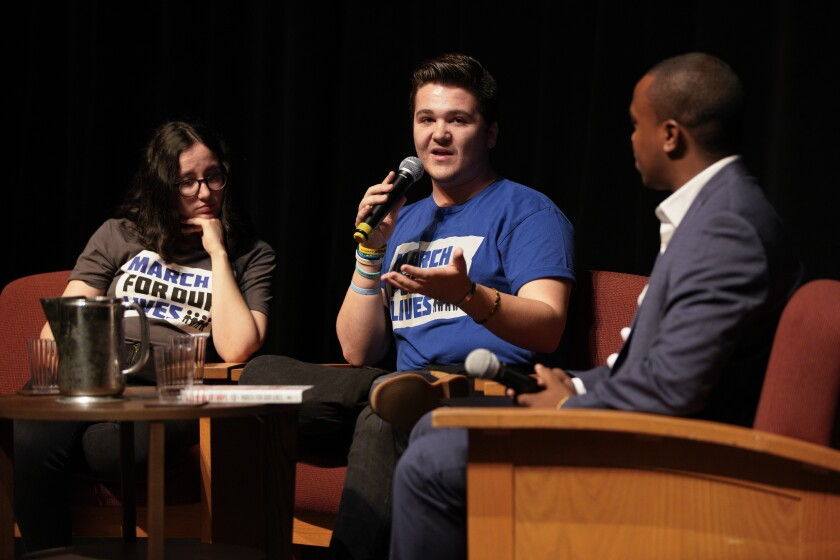 Sofie Whitney, 19, and Brendan Duff, 21 — both survivors of the Marjory Stoneman Douglas High School school shooting — sat on stage with Jordan Harrison (r) who moderated an open discussion about the March for Our Lives movement, which seeks sensible gun-violence prevention policies.