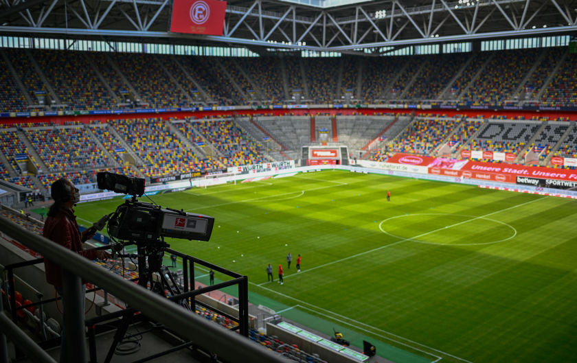 A TV camera operator works before a German first division Bundesliga football match in May in Duesseldorf.