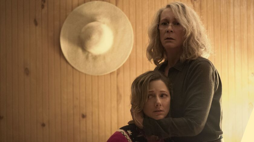 (L-R) - JAMIE LEE CURTIS on the set of Halloween with director DAVID GORDON GREEN. She returns to h