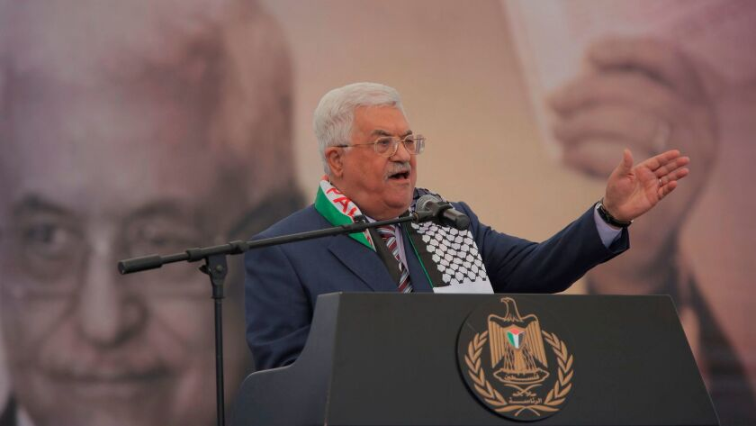 Palestinian President Mahmoud Abbas delivers a speech during a rally marking the 12th anniversary of