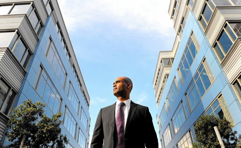 Clarion Partners Vice President Khalid Rashid is flanked by two Playa Vista buildings his company is revamping to appeal to creative tenants.