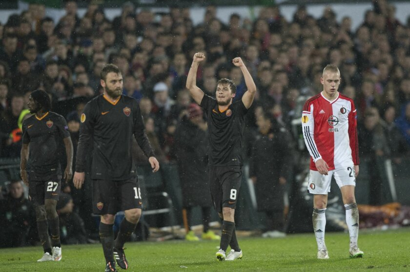 AS Roma's player Adem Ljajic celebrates scoring and makes it 0-1 during an Europa League round of 32 second leg soccer match between Feyenoord and AS Roma, at De Kuip stadium in Rotterdam, Netherlands, Thursday Feb. 26, 2015. (AP Photo/Ermindo Armino)