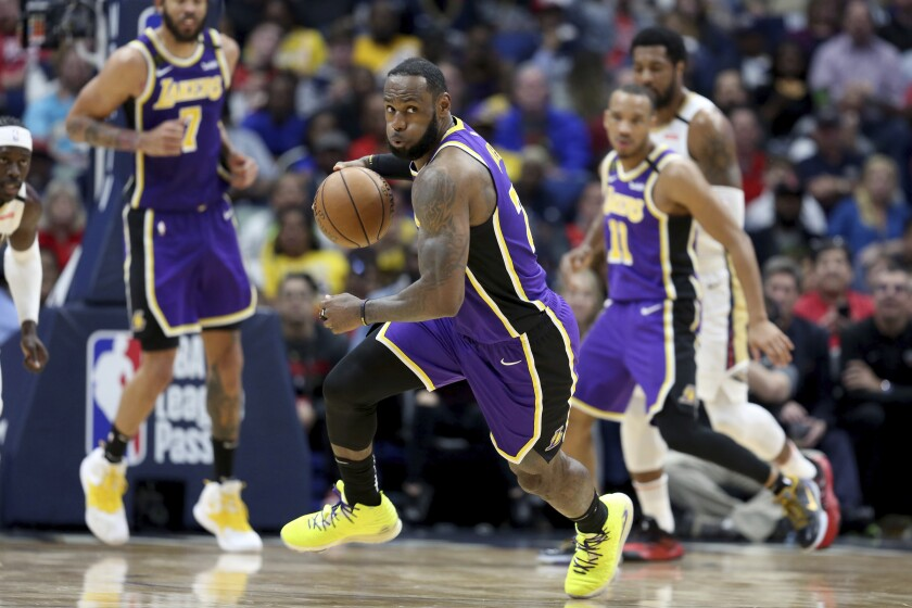 LeBron James drives to the basket during the Lakers' win over the New Orleans Pelicans on Sunday night.