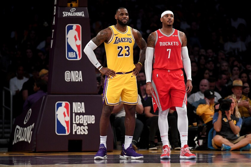 Lakers star LeBron James, left, stands next to Houston Rockets small forward Carmelo Anthony during a game on Oct. 20, 2018.