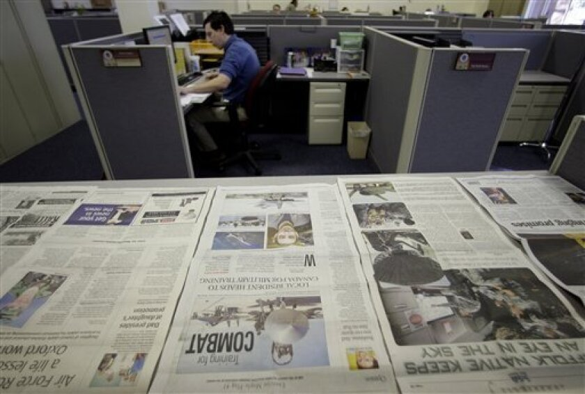 """The newsroom of the Joint Hometown News Service in San Antonio, Texas is seen on Thursday, Jan. 8, 2009. In a growing attempt to win what it calls """"the human terrain,"""" the Pentagon plans to spend more than $4.8 billion and employ more than 27,000 people this year to shape public opinion around the world. But critics worry that the Pentagon is using vast amounts of public money to shape the opinions of the American public. They dismiss the military's assertion that it is trying to educate rather than manipulate the American people. (AP Photo/Eric Gay)"""