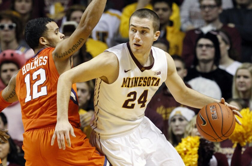 Minnesota forward Joey King (24) drives past Clemson guard Avry Holmes (12) during the first half of an NCAA college basketball game in Minneapolis, Monday, Nov. 30, 2015. (AP Photo/Ann Heisenfelt)