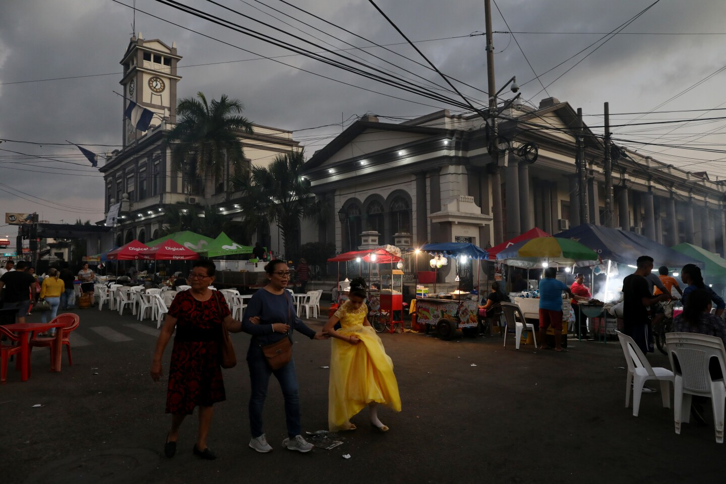 USULUTÁN, USULUTÁN -- FRIDAY, NOVEMBER 22, 2019: Vendors line the street in front of the municipal palace during the Patron Saint Festival in honor of la Virgen Santa Catarina de Alejandría in downtown Usulután, Usulután, on Nov. 22, 2019. Members of the graduating class of 1978 from the Instituto Nacional del Usulután attended their 41st class reunion. When the country plunged into a civil war in October 1979, many of them left for the United States and other parts of the world. Now, they're coming back together for a high school reunion, the second one. (Gary Coronado / Los Angeles Times)
