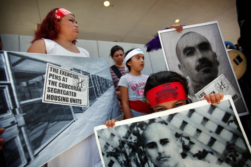 Three-year-old Salome Cuauhtemoc participates with his family in a rally in downtown L.A. in a show of support for state inmates on a hunger strike over prison conditions and to seek justice for Trayvon Martin, who was killed in Florida by George Zimmerman.