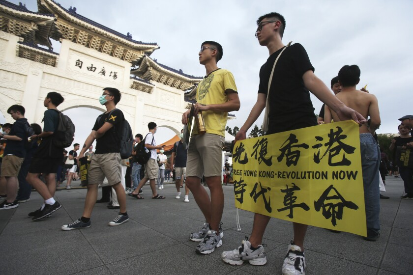 Hong Kong protesters and Taiwanese supporters gather Saturday in Taipei, Taiwan.
