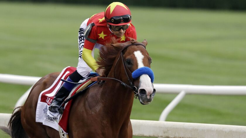 Jockey Mike Smith rides Justify into the far turn during the Belmont Stakes horse race, Saturday, Ju