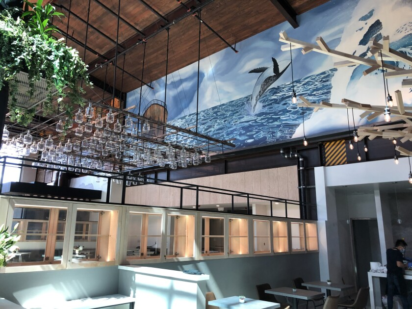 Inside the Sky Deck dining room at Del Mar Highlands Town Center, an ocean mural can be seen above the J.