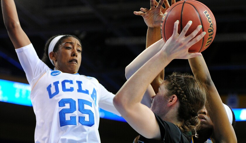 Hawaii's Megan Huff looks to shoot over UCLA's Monique Billings (25) and Kennedy Burke during their NCAA tournament game Saturday.