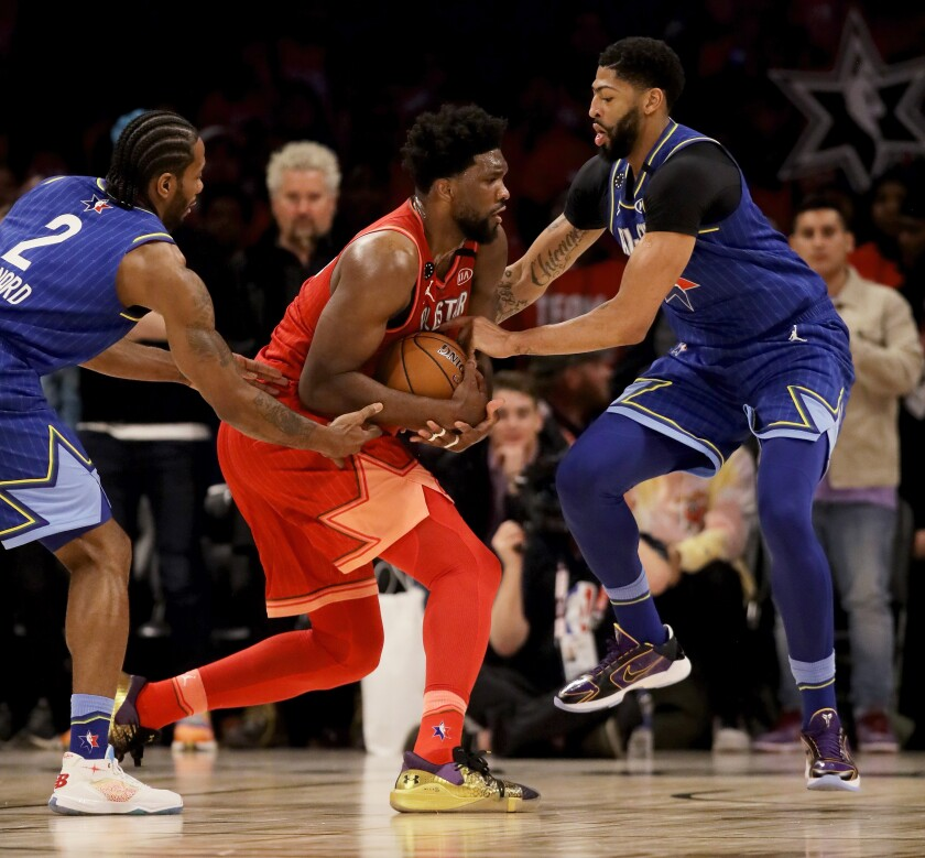 Kawhi Leonard, left, and Anthony Davis trap Joel Embiid during the All-Star game.