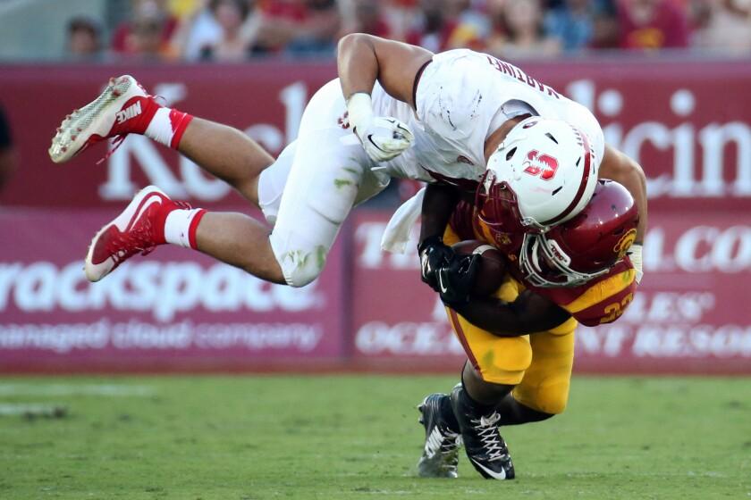 Stanford linebacker Blake Martinez brings down USC running back Tre Madden during the second half.