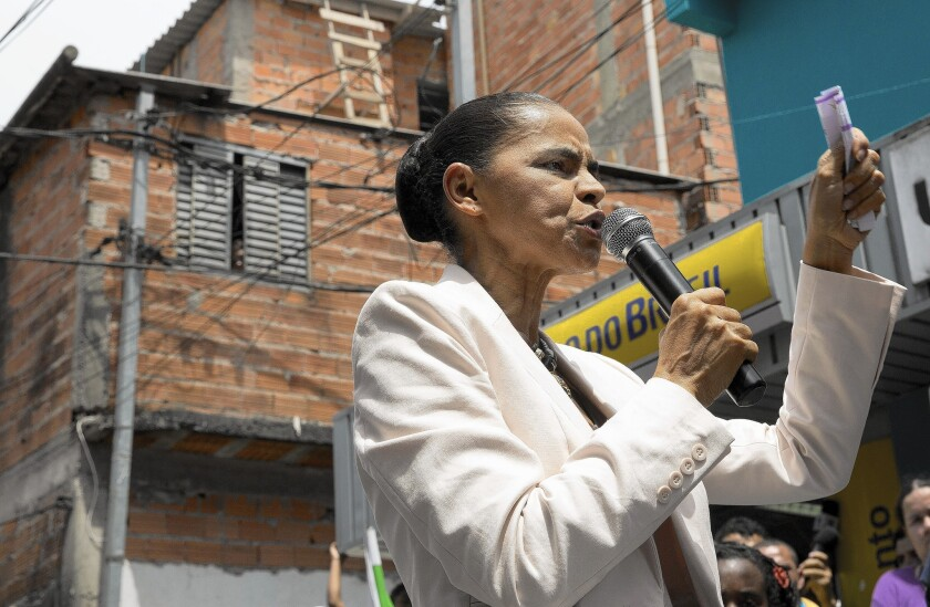 Presidential candidate Marina Silva campaigns in a slum in Sao Paulo, Brazil on Oct. 1. She has attacked incumbent Dilma Rousseff's handling of the economy.