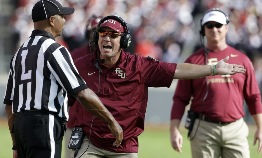 Florida State coach Jimbo Fisher argues with an official during the first half of an NCAA college football game against North Carolina State in Raleigh, N.C., Saturday, Sept. 27, 2014. (AP Photo/Gerry Broome)