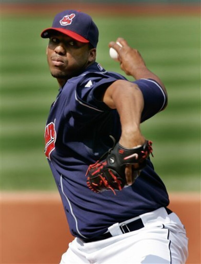 Cleveland Indians starter Fausto Carmona throws against the Toronto Blue Jays during first inning action of the first game of their baseball double-header in Cleveland on Monday, May 12, 2008. (AP Photo/Amy Sancetta)