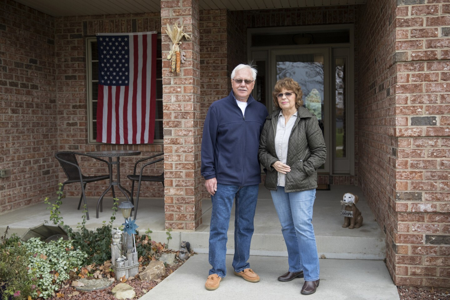 Roger and Dianne Klinkhammer, both 73, stand together outside their custom-built home where they have lived for 10 years in a tiny subdivision Nov. 13, 2017, in Mount Pleasant, Wis. Foxconn's new 20 million-square-foot manufacturing plant is to be built on land in Mount Pleasant that includes the couple's property and they are being forced to relocate.