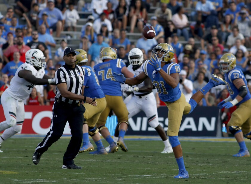 UCLA tight end Caleb Wilson bobbles the ball before making a catch against Cincinnati on Sept. 1.