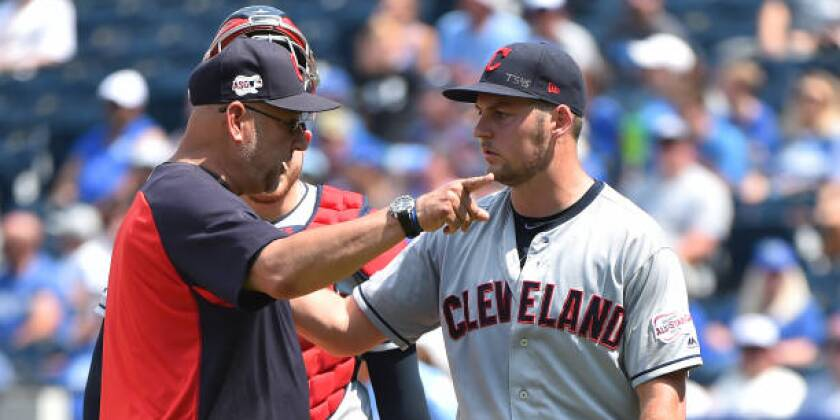 Cleveland Indians manager Terry Francona gestures as starting pitcher Trevor Bauer leaves the game in the fifth inning Sunday against the Kansas City Royals.