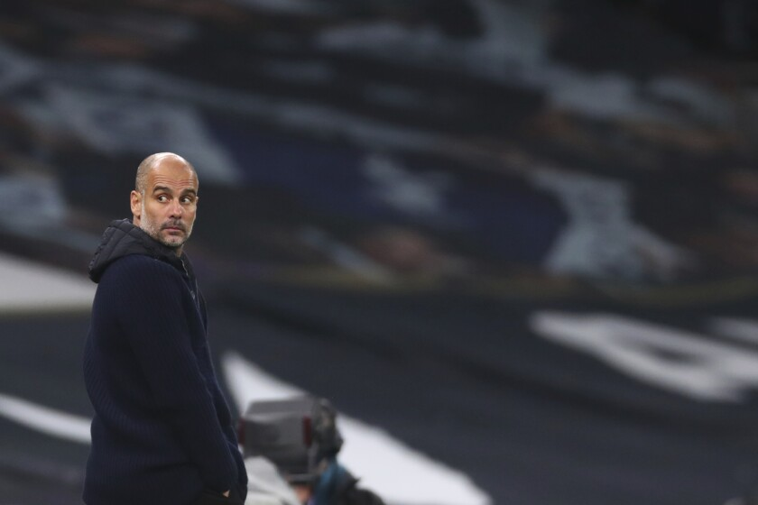 Manchester City's head coach Pep Guardiola gestures during the English Premier League soccer match between Tottenham Hotspur and Manchester City at Tottenham Hotspur Stadium in London, England, Saturday, Nov. 21, 2020. (Clive Rose/Pool via AP)