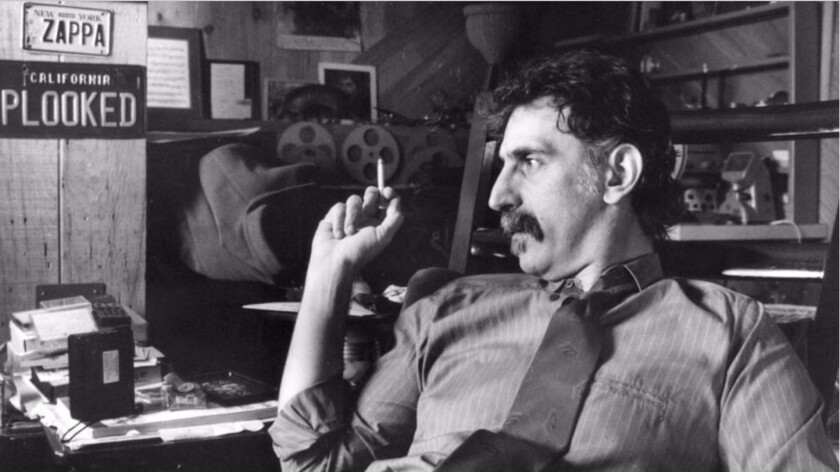 Frank Zappa sits in his home office in 1989.