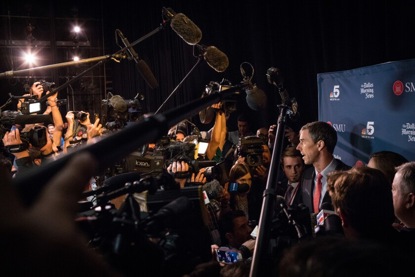 Rep. Beto O'Rourke (D-TX) is mobbed by members of the media as he answers questions following his de