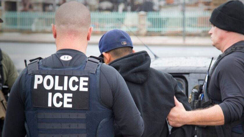 This Feb. 7, 2017, photo released by U.S. Immigration and Customs Enforcement shows foreign nationals being arrested during a targeted enforcement operation conducted by U.S. Immigration and Customs Enforcement (ICE).