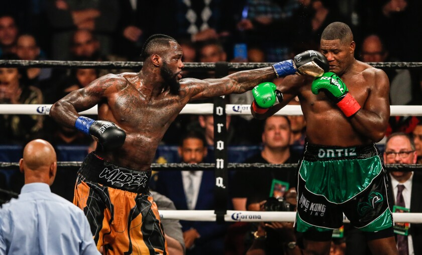 Deontay Wilder delivers a punch against Luis Ortiz in New York on March 3, 2018.