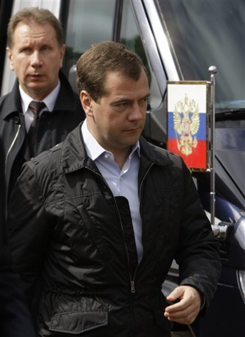Russia's President Dmitry Medvedev seen during his visit to the Sevmash factory in the northern city of Arkhangelsk on Thursday, July 2, 2009. Medvedev on Thursday criticized the holdup in refurbishing a Soviet-era aircraft carrier that was bought by India five years ago. (AP Photo/Alexander Zemlianichenko, Pool)